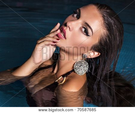 Sexy Girl With Dark Hair Posing In Swimming Pool