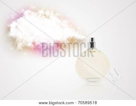 women's perfume in beautiful bottle spraying colorful cloud, copyspace in cloud