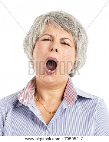 Portrait of a elderly woman with a sleepiness expression