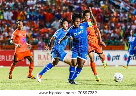 Sisaket Thailand-august 13: Yuttana Chaikaew Of Ptt Rayong Fc. (blue) In Action During Thai Premier