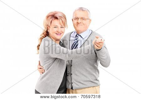 Mature couple dancing tango isolated on white background
