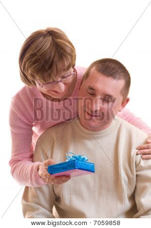 Mature Happy Couple With Gift Box