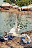 image of trough  - on the bank of a miracle boat with sails trough - JPG
