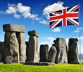 picture of stonehenge  - Historical monument Stonehenge with flag in England - JPG