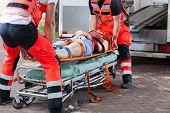 foto of stretcher  - Woman after accident on the stretcher horizontal - JPG