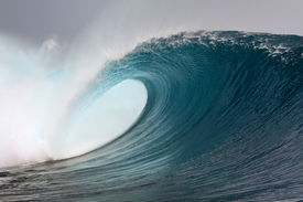 foto of breaker  - Large blue surfing wave breaking over coral reef in the Mentawai Islands - JPG