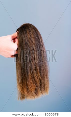 Hair Wig Against The Background