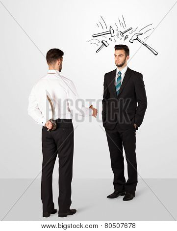 Ruthless businessman hiding a weapon white drawn beating hammer marks