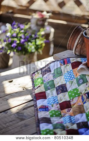 handmade colorful quilt blanket in sunny spring garden