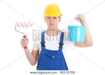 Young Man Painter In Blue Coveralls With Paint Brush And Bucket Isolated On White