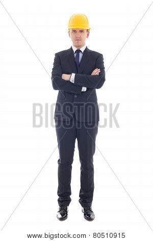 Full Length Portrait Of Handsome Business Man In Yellow Builder's Helmet  Isolated On White