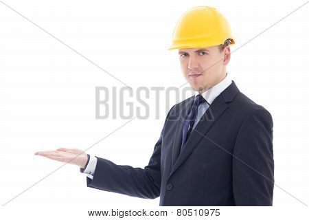 Handsome Business Man Or Architect In Yellow Builder's Helmet Holding Something On Hand Isolated On