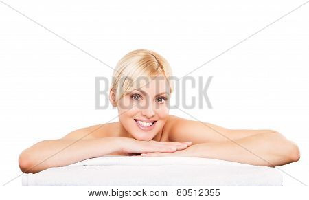 Young beautiful woman relaxing at spa isolated on white background, professional beauty makeup