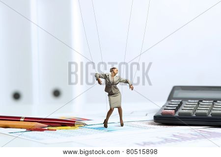 businesswoman puppet doll is on the desk