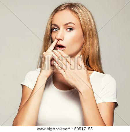 Woman picks his nose finger. Female climbs a finger in nose. Embarrassment