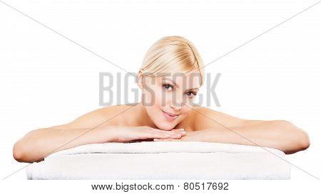 Beauty Portrait. Beautiful Spa Woman on white towel.