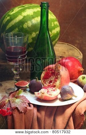 Still-life With Wine, A Pomegranate, A Fig And A Water-melon