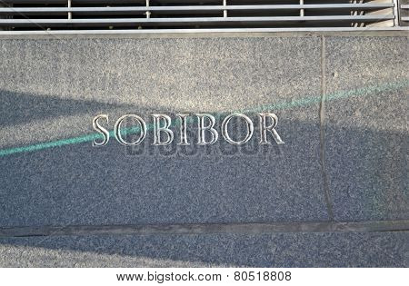Sobibor, Message Closeup On Stone Wall