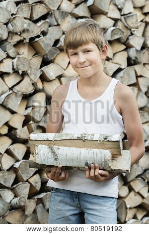 Portrait of teenage woodcutter at firewood