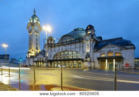 LIMOGES, FRANCE - SEPTEMBER 9, 2013: Limoges-Benedictins Train Station in evening. Built in 1929, it's considered as one of the most beautiful train station in the world