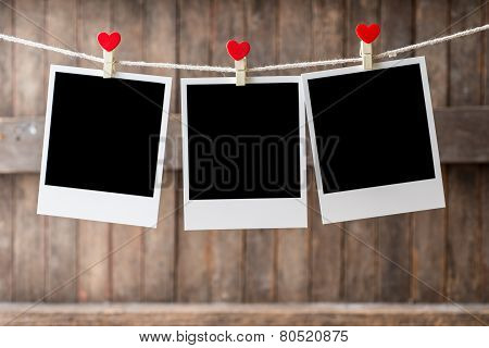 Three Old Picture Frame Hanging On The Clothesline