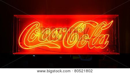 BANGKOK, THAILAND - NOV 11: Coca Cola red sign on November 11, 2014. Coca-Cola is a carbonated soft drink sold in stores, restaurants, and vending machines throughout the world