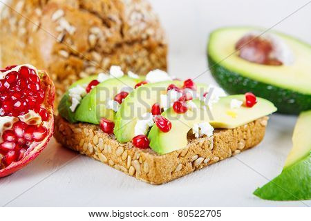 Avocado With Feta, Pomegranate On Sunflower Seeds Bread Sandwich.