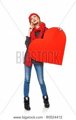 Full length girl holding up a red cardboard heart