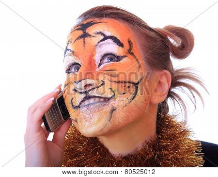 Girl a tiger speaks on a mobile telephone.