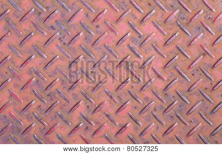 Rusty metal diamond plate background and texture