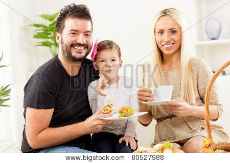 Happy Family Eats Pastry For Breakfast