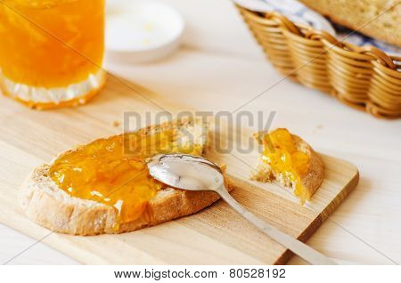 Orange Marmalade Spread Spoon On Homemade Fresh Bread