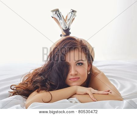 Portrait of sexy young woman posing at camera