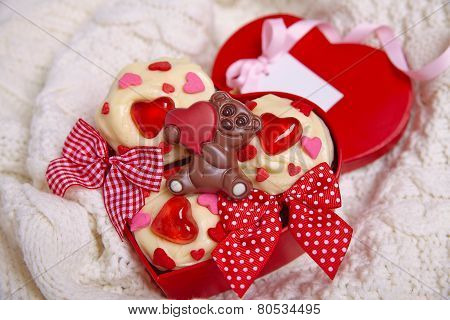 Red velvet cupcakes decorated with hearts
