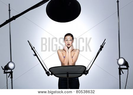 Young model posing in professionally equipped studio