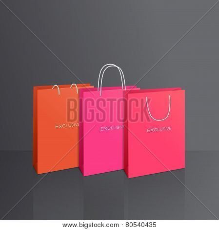 Colorful paper bags set isolated on grey background