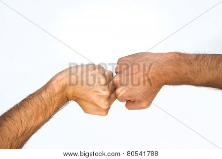 Two orientations of a man clenching his fist viewed from above, one with a bent wrist and one straight, with the fists touching, close up view of the arm isolated on white