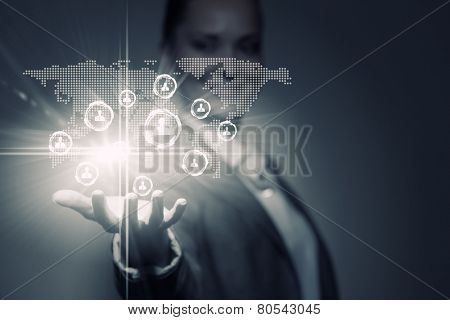 Close up of businesswoman holding media icons in palm