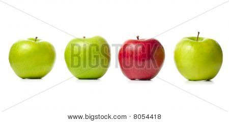 Three Green Apples And One Red Isolated On White