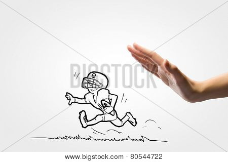 Close up of human hand and caricature of running baseball player