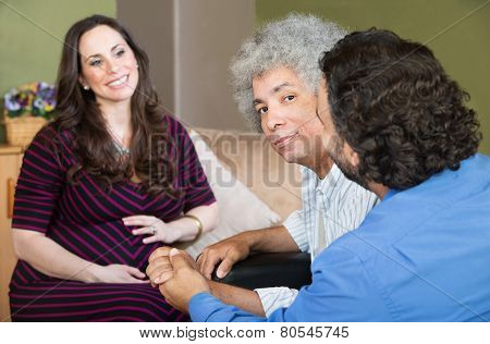 Smiling Surrogate Mother With Gay Couple