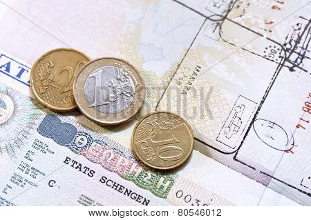 Euro coins on passport with greek European Union visa
