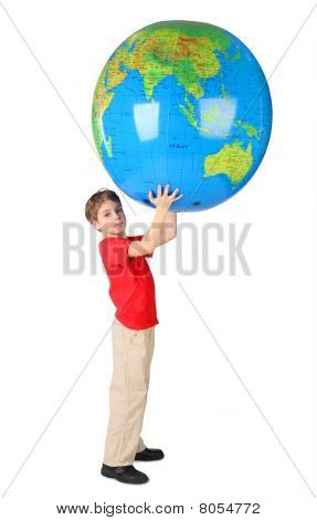 Boy In Red Shirt Holding Big Inflatable Globe Over His Head Side View Isolated