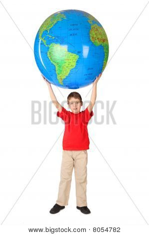 Boy In Red Shirt Holding Big Inflatable Globe Over His Head Full Body Isolated