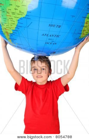 Boy In Red Shirt Holding Big Inflatable Globe Over His Head Isolated