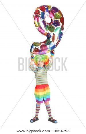 Boy In Clown Dress With Balloon Shape Nine Over His Head Isolated On White Background