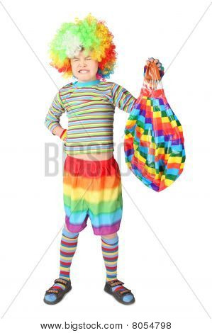 Boy In Clown Dress With Multicolored Baloon Isolated On White Background