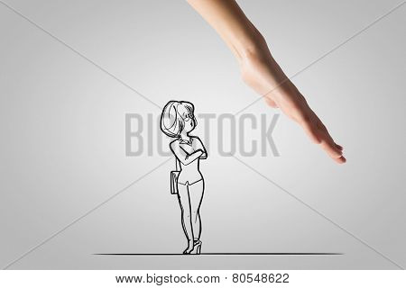 Human hand and funny caricature of businesswoman