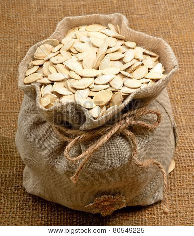 Pumpkin Seeds In The Bag On The Sacking Background