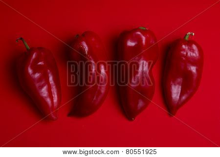 Red Peppers On Red Background